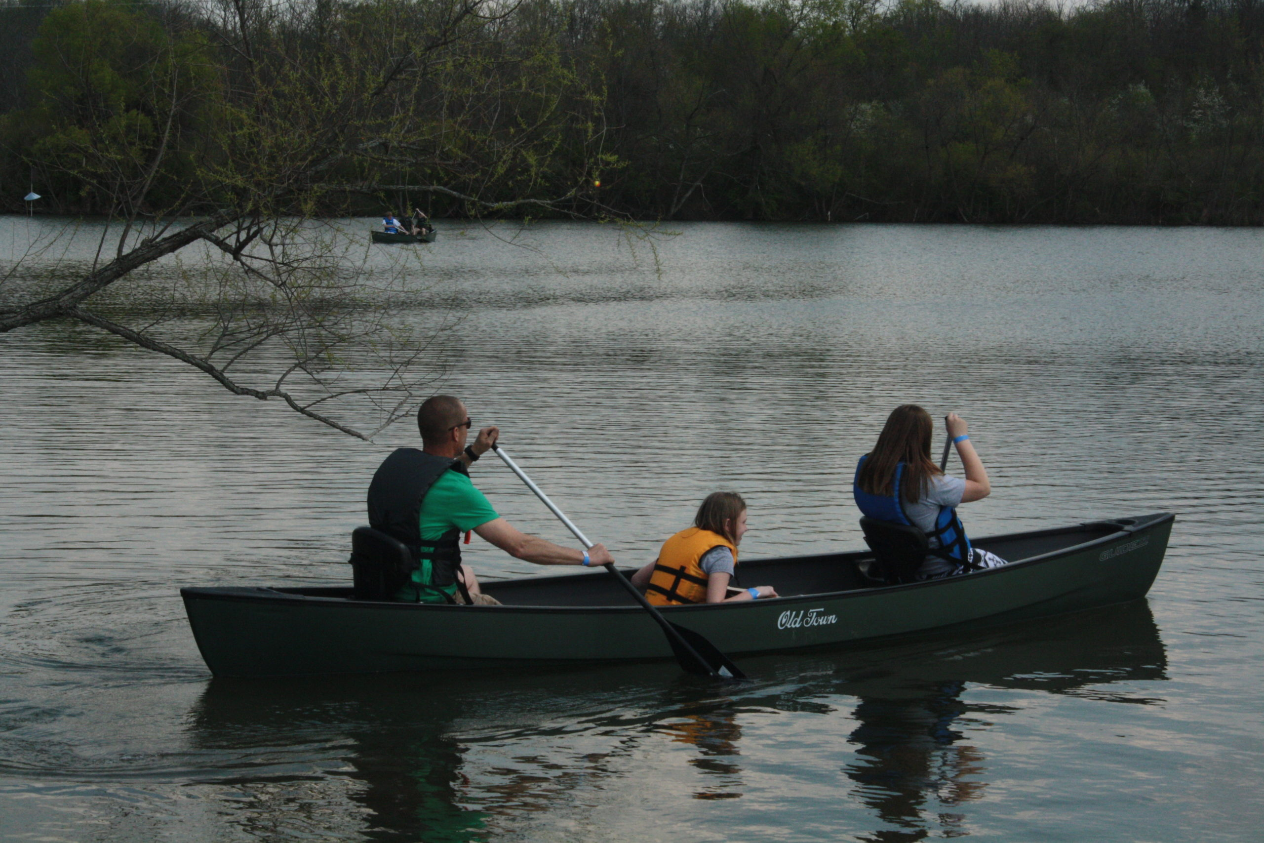 A group of people canoeing out on the water