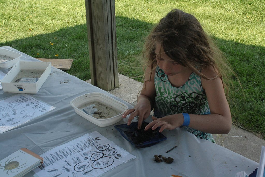 A girl participating in a craft
